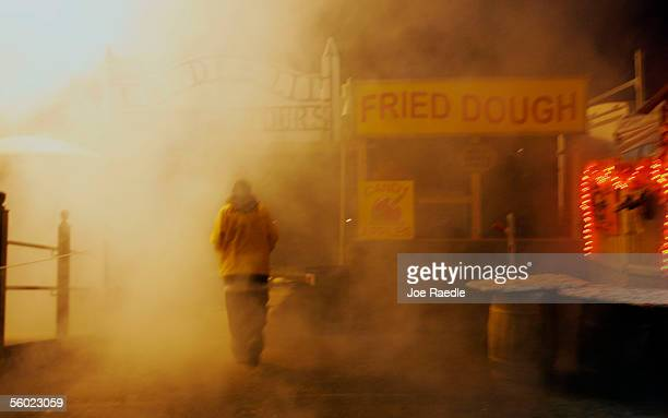 A visitor walks through a cloud of smoke created by dry ice in a town where back in 1692 witch trials took place October 27 2005 in Salem...