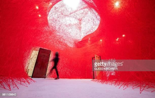 TOPSHOT A visitor walks through a room where the installation Secret Passage by Japanese artist Chiharu Shiota is on display during a preview of the...