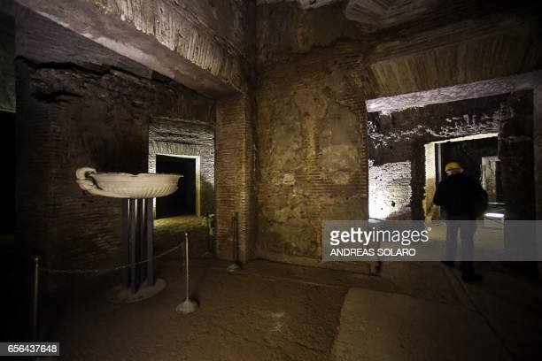 A visitor walks through one of the rooms of the Domus Aurea a large palace built by the Roman Emperor Nero in the first century during a exhibition...
