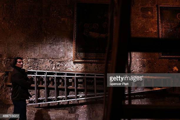 A visitor walks through the Church of the Holy Sepulchre on November 29 2014 in Jerusalem Israel The church is said to be where Jesus was crucified...
