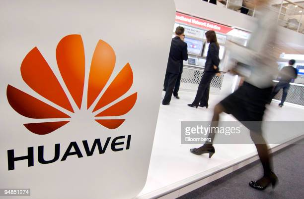 A visitor walks through the Huawei Technologies Co booth at the 2008 GSMA Mobile Asia Congress in Macau China on Tuesday Nov 18 2008 The 2008 GSMA...