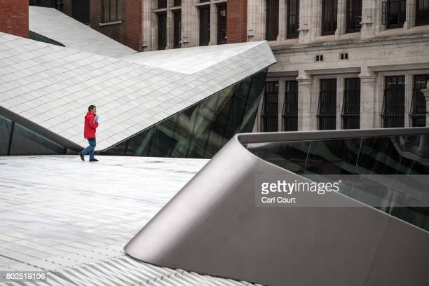 A visitor walks through the new allporcelain public courtyard at the Victoria and Albert Museum on June 28 2017 in London England The new public...
