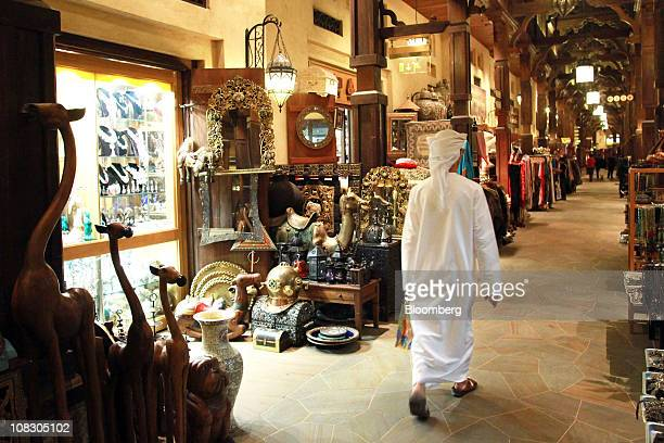 A visitor walks through the Souk Madinat a market place with craft shops inside the Madinat Jumeirah resort operated by the Jumeirah Group LLC in...