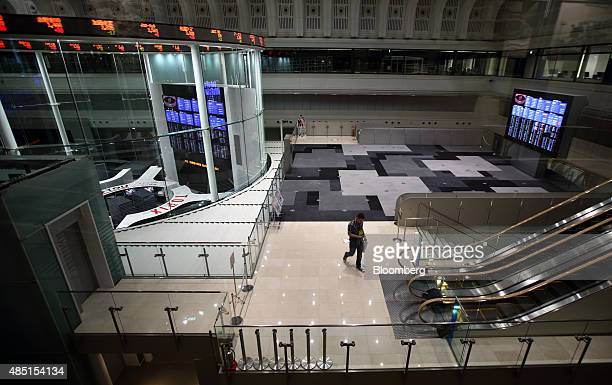 A visitor walks through the Tokyo Stock Exchange operated by Japan Exchange Group Inc in Tokyo Japan on Tuesday Aug 25 2015 Japanese stocks swung...