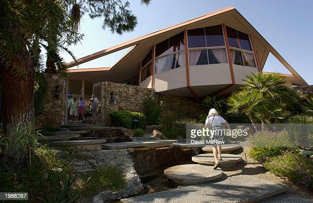 A visitor walks under the bedroom of the Elvis Presley 'Honeymoon Hideaway' house on May 9 2003 in Palm Springs California Elvis fans are attending...