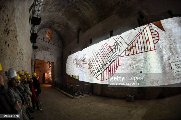 Visitor watch a film projected onto a wall in one of the rooms of of the Domus Aurea a large palace built by the Roman Emperor Nero in the first...