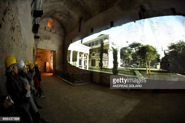 Visitor watch a film projected onto one of the walls of the Domus Aurea a large palace built by the Roman Emperor Nero in the first century during a...