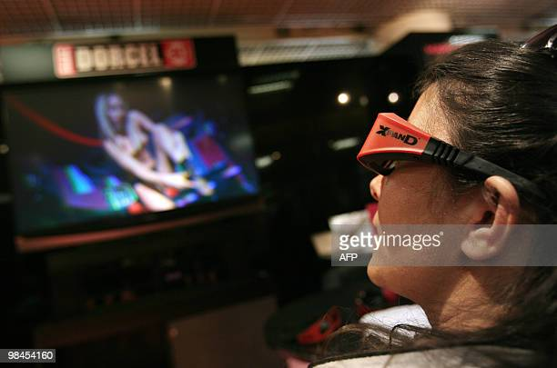 A visitor watches a 3D porn movie on April 13 2010 in Cannes southern France taken during the MIPTV one of the world's largest broadcasting and...