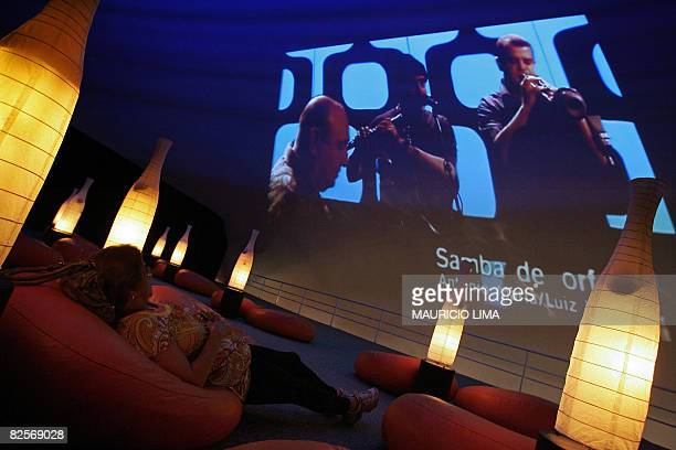 A visitor watches a video presentation as part of an exhibition to celebrate the 50th anniversary of Brazilian movement and musical style 'Bossa...