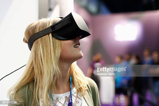 A visitor watches exclusively the new Syfy hybrid show 'Halcyon' at the Gamescom 2016 gaming trade fair during the media day on August 17 2016 in...