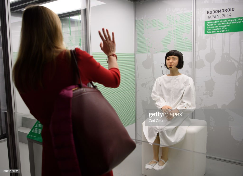 A visitor waves at a Kodomoroid communications android from Japan during the press preview for the 'Robots' exhibition at the Science Museum on February 7, 2017 in London, England. The exhibition showcases robot history going back 500 years with over 100 robots including the largest collection of humanoid robots ever displayed.