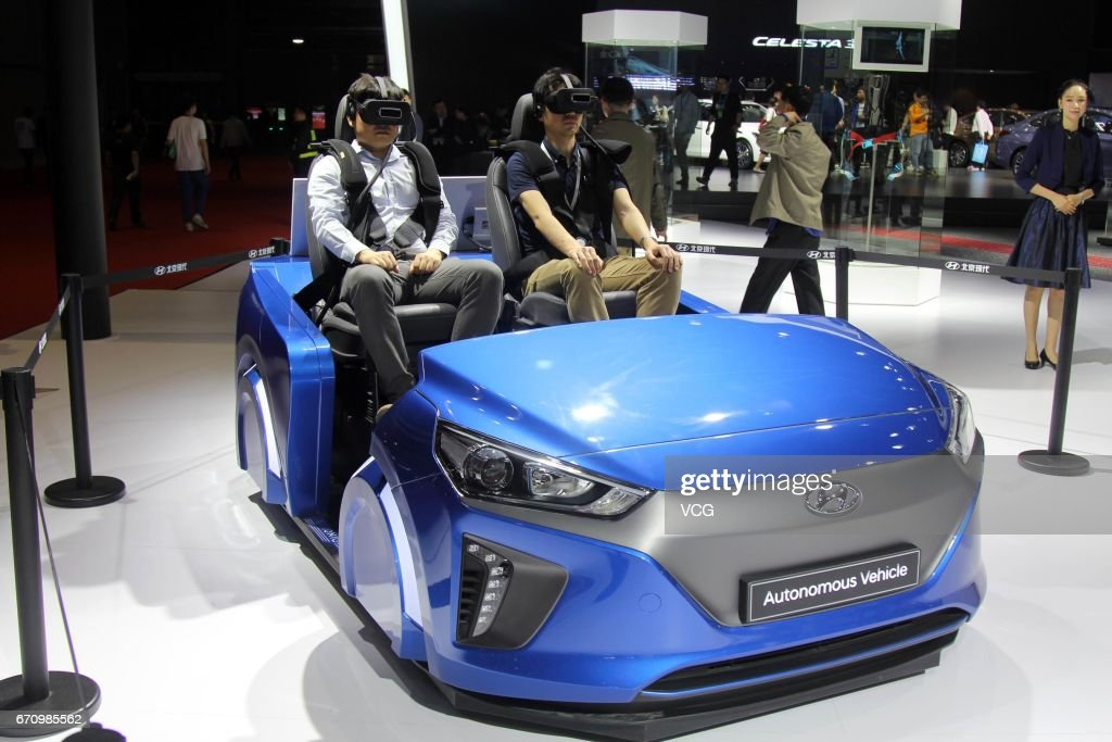 Visitor wear virtual reality (VR) devices to experience virtual driving during the media day of 17th Shanghai International Automobile Industry Exhibition on April 20, 2017 in Shanghai, China. The 17th Shanghai International Automobile Industry Exhibition will be held at National Exhibition and Convention Center (Shanghai) from April 21 to April 28.