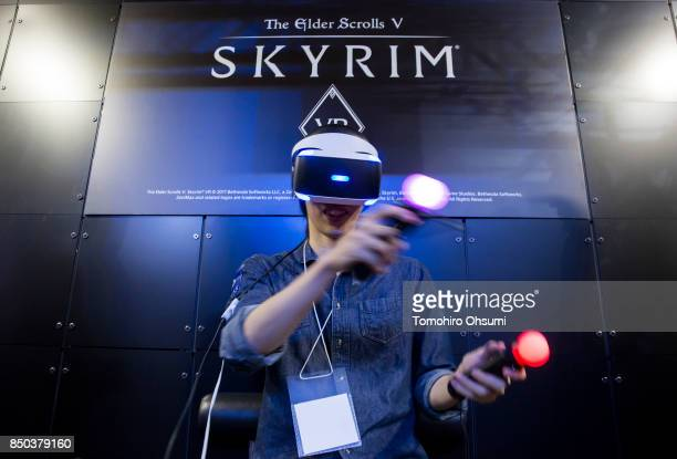 Visitor wearing a PlayStation VR headset plays a video game in the Sony Interactive Entertainment Inc. Booth during the Tokyo Game Show 2017 at...