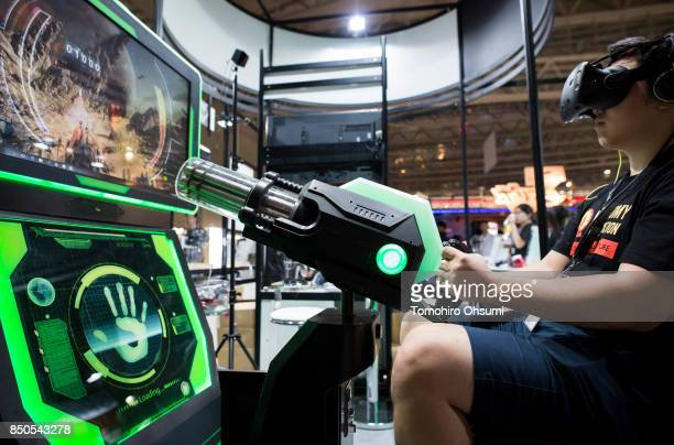 A visitor wearing a virtual reality headset plays a VR video game during the Tokyo Game Show 2017 at Makuhari Messe on September 21 2017 in Chiba...