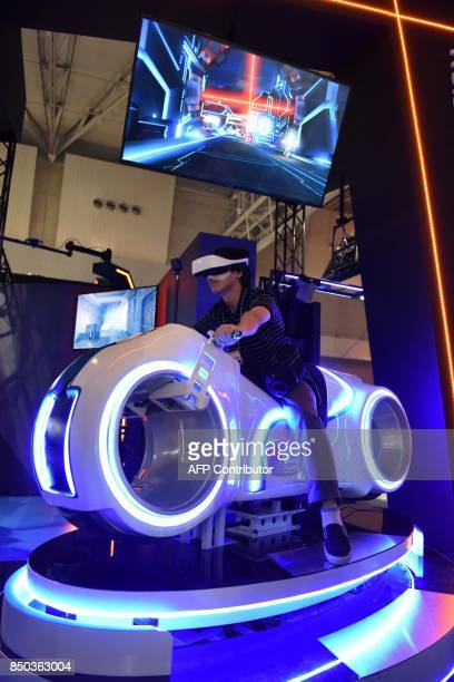 Visitor wearing a virtual reality headset tries out one of the exhibitions at the Tokyo Game Show in Chiba City, in suburban Tokyo on September 21,...