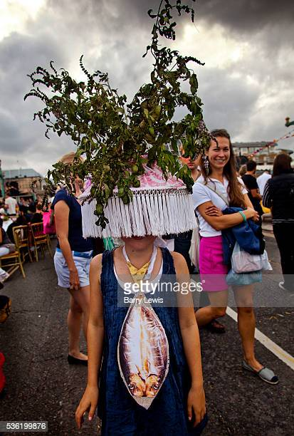 Visitor wearing outfits by Zoe Cameron and Damaris Booth, who make fish and edible hats, on Southwark Bridge which is transformed into a giant...