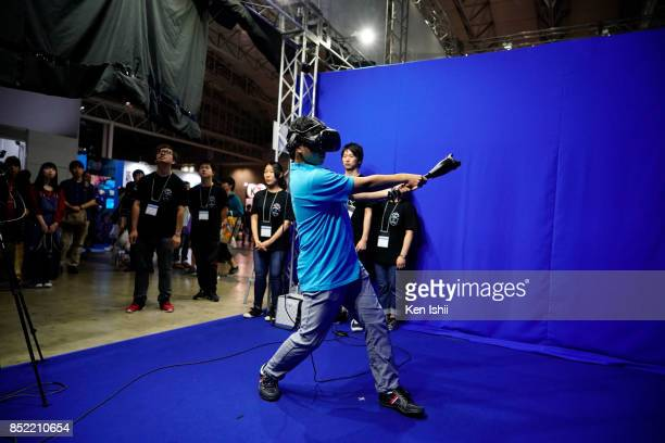 Visitor wearing VR headset plays the game at the HTC Corp booth during the Tokyo Game Show 2017 at Makuhari Messe on September 23 2017 in Chiba Japan