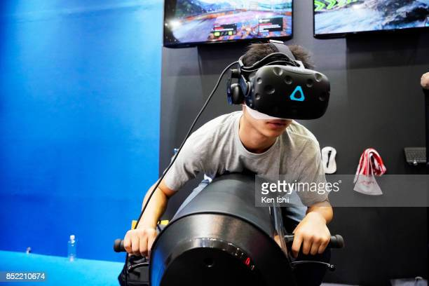 A visitor wearing VR headset plays VR simulator at the JPW international booth during the Tokyo Game Show 2017 at Makuhari Messe on September 23 2017...