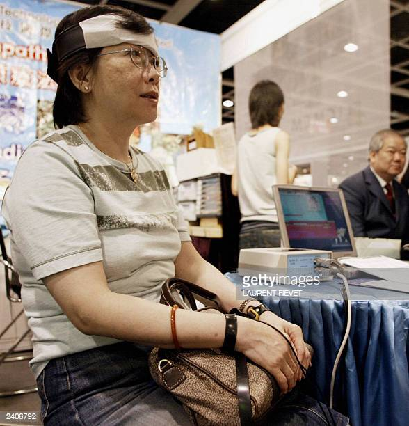 A visitor wears a head harness and wrist straps which are attached to a digital box and connected externally to a computer using the Quantum Xrroid...