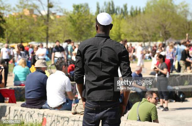 A visitor wears a kippah or yarmulke handed out by volunteers in the Mauerpark public park during a day of demonstrations against antisemitism on...