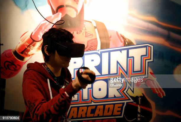 A visitor wears a virtual reality headset as he plays a video game Sprint Vector developed and published by Survios during the 'Virtuality Paris...