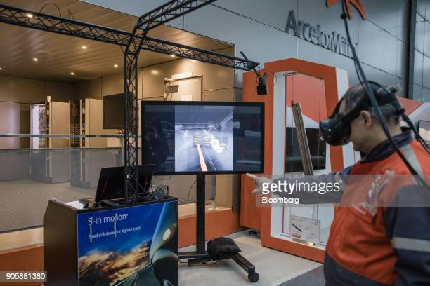 A visitor wears a virtual reality headset at the ArcelorMittal research and development center in Montataire France on Tuesday Nov 28 2017 The...