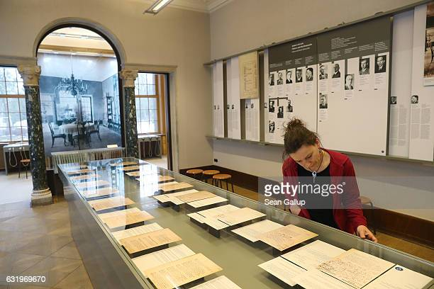 A visitor who said she did not mind being photographed looks at exhibits in the villa known as The House of the Wannsee Conference on January 18 2017...