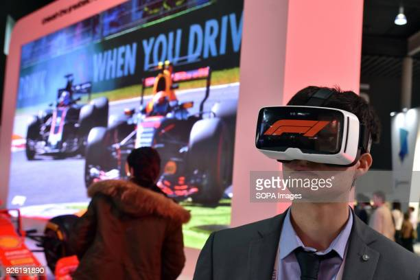 A visitor with a virtual reality goggles in the stand of Formula 1 at the Mobile World Congress in Barcelona The Mobile World Congress 2018 is being...