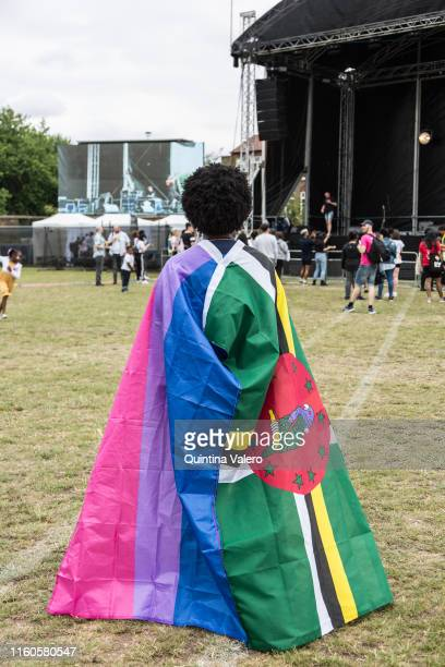 A visitor with the LBGT and Jamaica flag at the UK Black Pride event in Haggerston Park in London United Kingdom on July 7th 2019