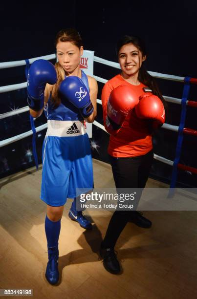 A visitor with the wax statue of Indian boxer Mary Kom during the launch of 'Madame Tussauds Wax Museum' in New Delhi
