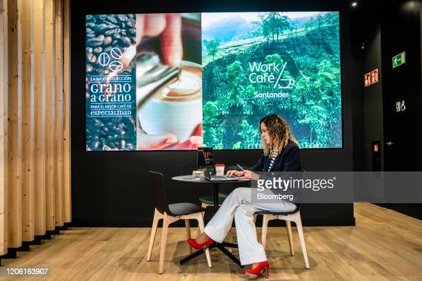 A visitor works at a laptop computer inside the Banco Santander SA Work Cafe coworking space in Barcelona Spain on Friday March 6 2020 Spanish bank...