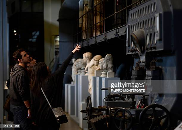 Visitores look at sculptures displayed in the Centrale Montenartini museum on October 26 2012 in Rome The museum shows hundreds of sculptures as a...