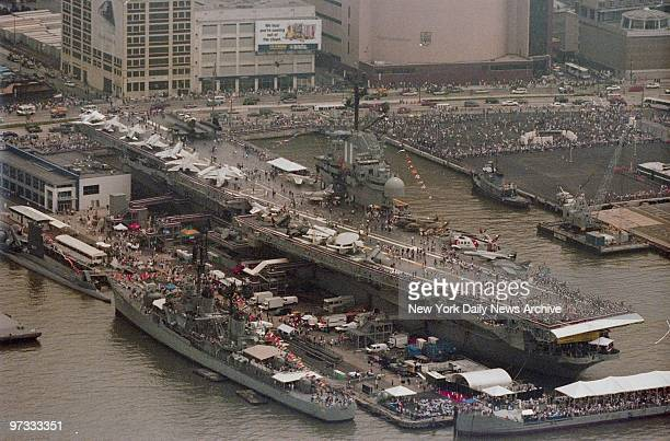 Visitors aboard the Intrepid SeaAirSpace Museum have a good spot for viewing the tall ships taking part in OpSail 2000 on the Hudson River