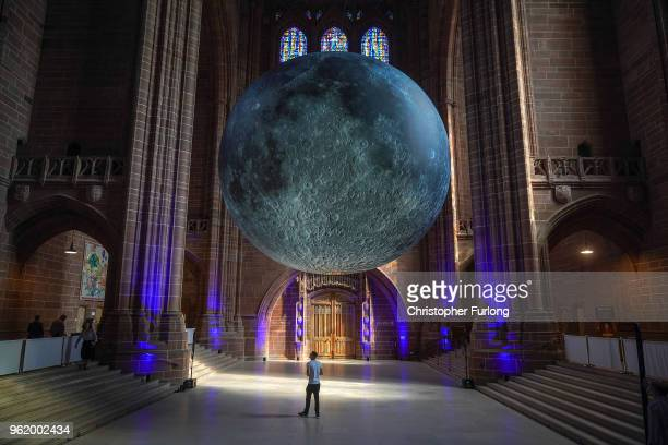 Visitors admire artist Luke Jerram's installation 'Museum of the Moon' at Liverpool Cathedral part of the 'Changing Tides' creative programme curated...