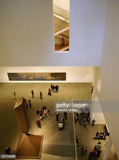 Visitors admire Barnett Newman's Broken Obelisk in the main atrium of the Museum of Modern Art after it reopened to the general public 20 November...