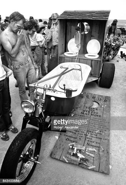 Visitors admire custom motorcycles on display in Daytona Beach Florida during the city's 1983 Bike Week The annual motorcycle event and rally has...