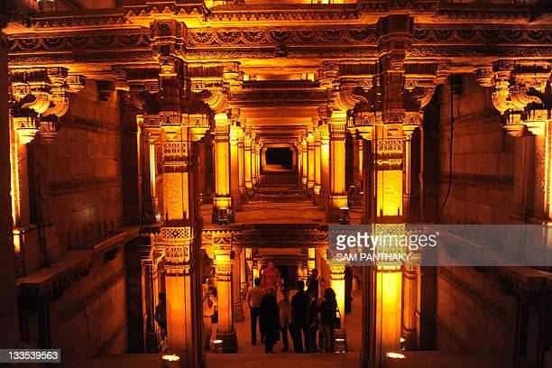 Visitors admire the illuminated AdalajNiVav step well at Adalaj in Gandhinagar District some 30km from Ahmedabad on November 19 2011 The illumination...