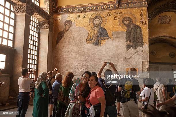 Visitors admire the mosaic of Jesus Christ  Hagia Sophia Istanbul