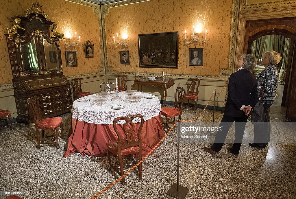 Visitors admire the reconstruction of a dining room at Palazzo Mocenigo during the press preview of the perfume exhibition on October 29, 2013 in Venice, Italy. The new perfume section at the Venetian Museum of eighteenth-century lifestyle Palazzo Mocenigo will open on the 1st of November.