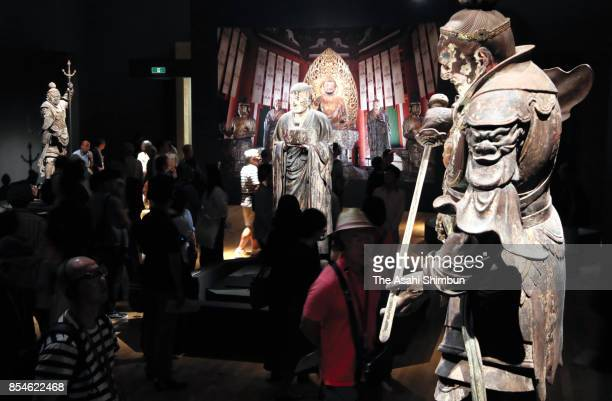 Visitors admire the standing statues from all sides at the special exhibition 'UnkeiThe Great Master of Buddhist Sculpture' at Tokyo National Museum...