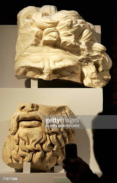 Visitors admire two fragmnts of a statue inside the new renovated Forum of Trajan in Rome 17 October 2007 The trajan's Markets and the Museo dei Fori...