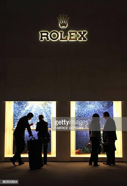 Visitors admire watches at the stand of Swiss watchmaker Rolex during the opening day of Baselworld 2008 watch and jewellery show on April 3 2008 in...