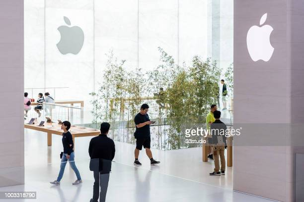 Visitors and buyers at the Apple Inc. Store in Macau, China, on July 18, 2018. As per Apple's financial results for its fiscal 2018 second quarter...