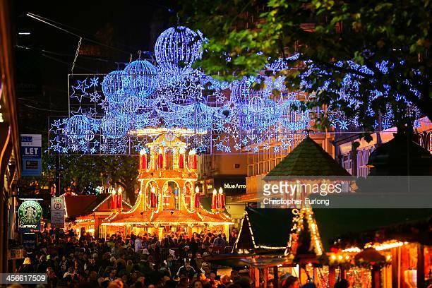 Visitors and Christmas shoppers enjoy Birmingham's Frankfurt Christmas market on December 3 2013 in Birmingham England Birmingham's Frankfurt...