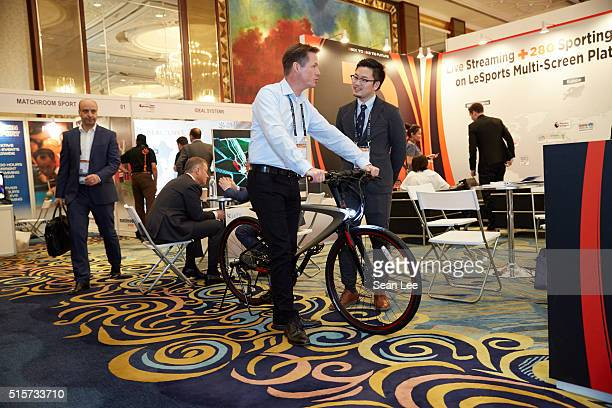 Visitors and exhibitors network at the LeSports booth during the Sportel Asia Conference on March 15 2016 in Singapore