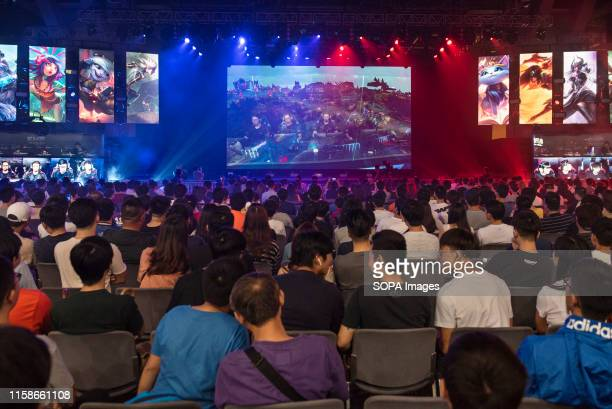 Visitors and fans watch at the main stage the official League of Legends International College Cup final game competition during the ESports and...