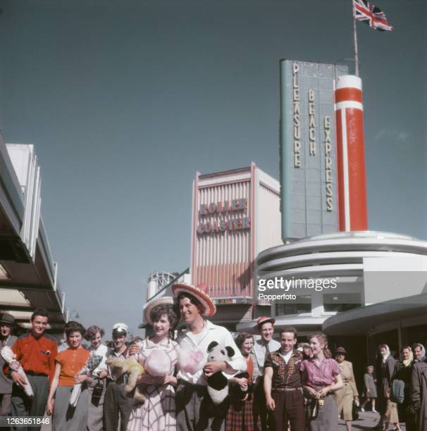 Visitors and holidaymakers enjoy a trip to Blackpool Pleasure Beach amusement park in the seaside resort of Blackpool Lancashire in July 1952