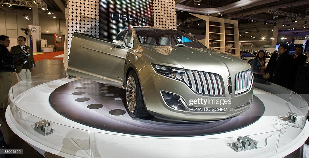 https://media.gettyimages.com/photos/visitors-and-journalists-watch-the-lincoln-mkt-concept-car-valued-in-picture-id83026122