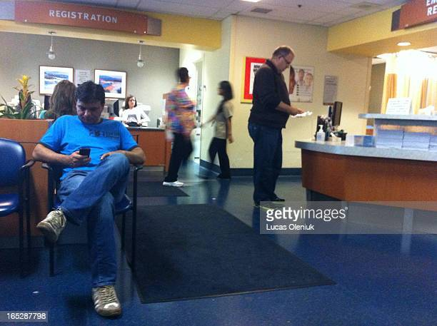 Visitors and patients wait inside the Credit Valley Hospital emergency room Tuesday evening after it was announced that the hospital has some of the...