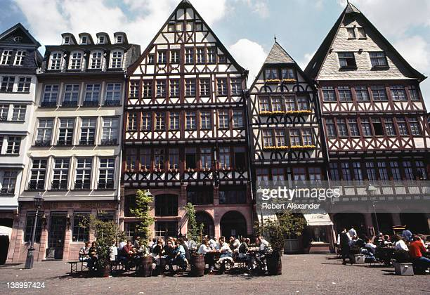 Visitors and residents enjoy Frankfurt Germany's main square The Romerberg in the city's Altstadt The east side of the square is known as the...